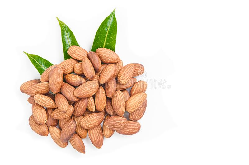 Almonds nuts with green leaf. stock photo