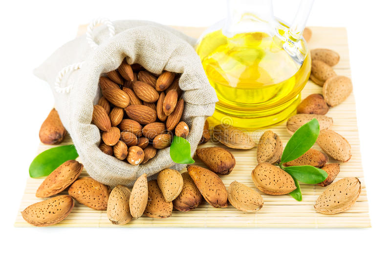 Almonds in the sack and almond oil royalty free stock photography
