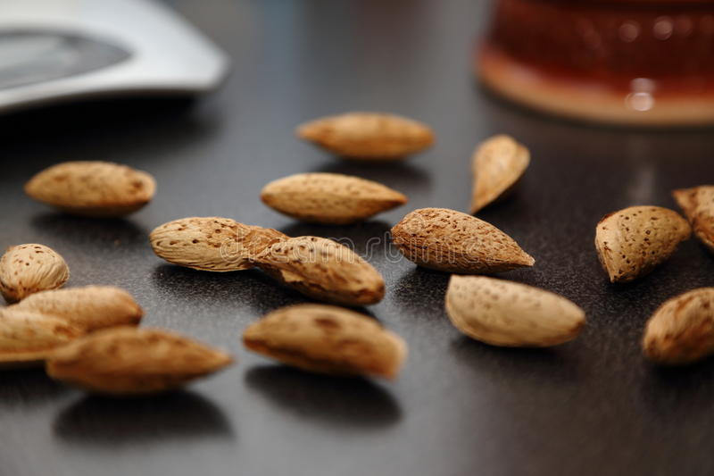 Almonds in shell. Nuts almonds in the shell on the table closeup royalty free stock photos