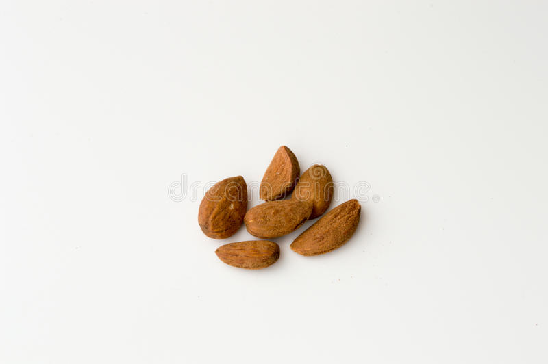 Almonds on a White Backgound. Top View of Almonds on a White Backgound stock images