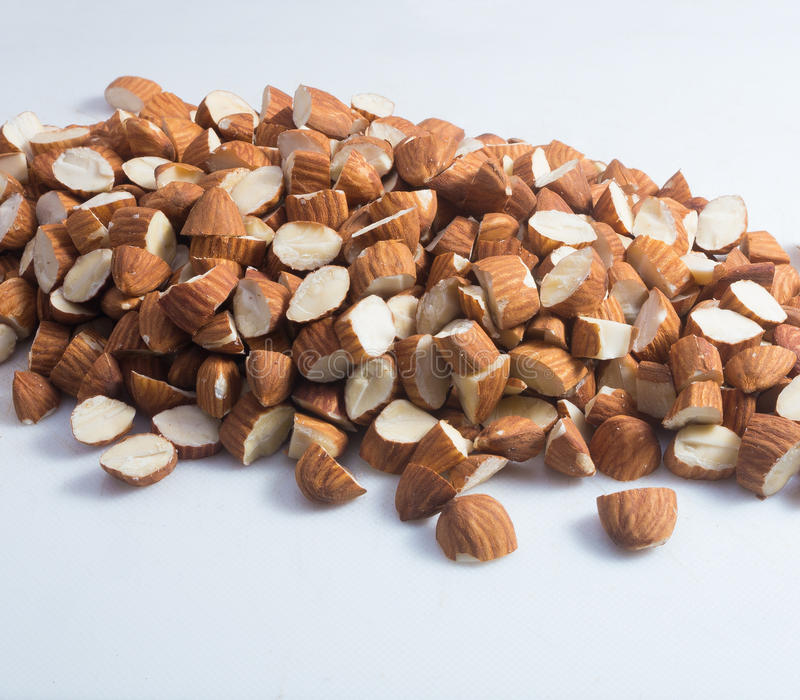 Almonds on white nackground. A pile of almonds arranged on a white background royalty free stock photos