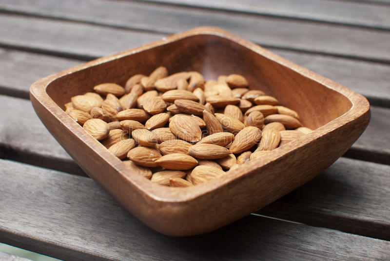 Almonds In Wooden Bowl Stock Photo