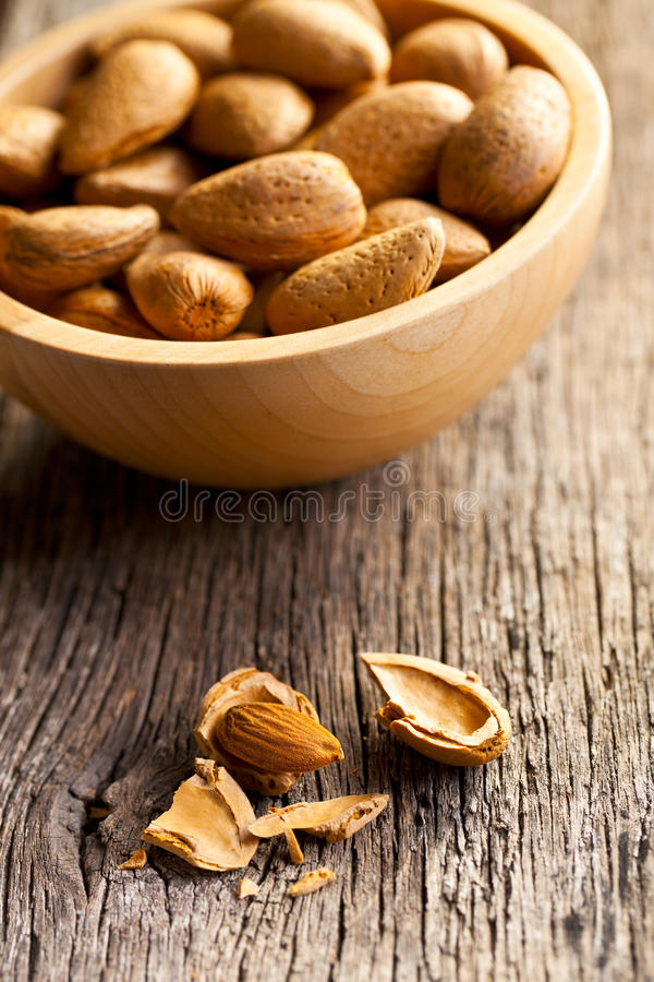 Download Almonds in wooden bowl stock image. Image of brown, object - 28837921