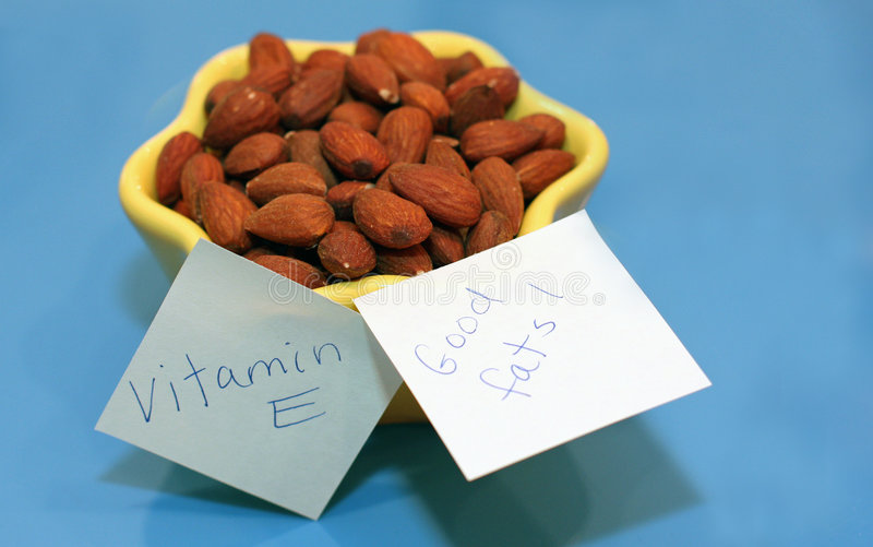 Download Almonds In Yellow Dish And Blue Background Stock Image - Image: 8413845