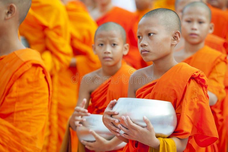 Alms-giving ceremony in Bangkok stock image