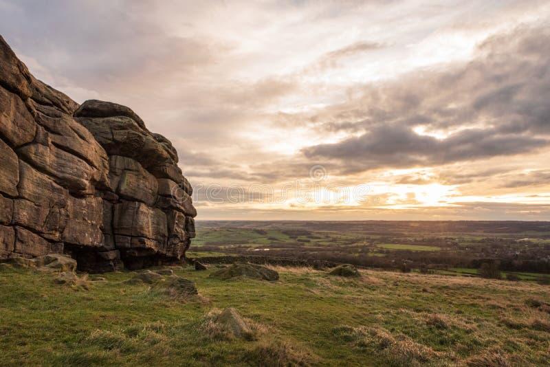 Almscliffe Crag overlooking farm fields royalty free stock photo