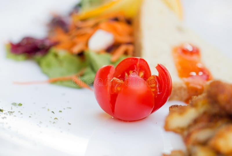 Almuerzo con el tomate foto de archivo libre de regalías