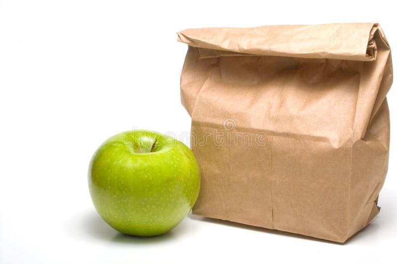 Almuerzo del bolso y un Apple imagen de archivo