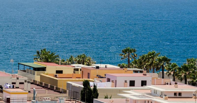 ALMUNECAR, SPAIN - JUNE 8, 2018 View of the tourist town of Almunecar on the Costa Tropical in Spain. ALMUNECAR, SPAIN - JUNE 8, 2018 Landscape of the famous stock photos