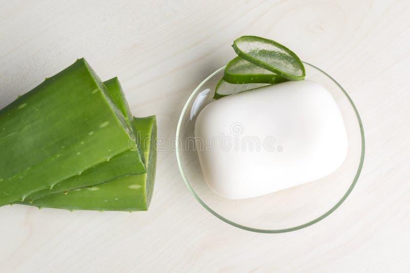 Aloe Vera. Fresh aloe vera leaves with soap royalty free stock photography