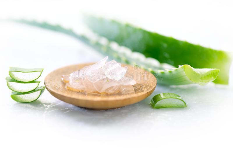 Aloe Vera gel closeup. Sliced aloevera leaf and gel, natural organic cosmetic ingredients for sensitive skin, alternative medicine royalty free stock image