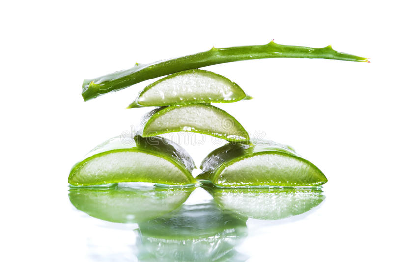 Aloe vera slices. Organic aloe vera slices on white background royalty free stock photos