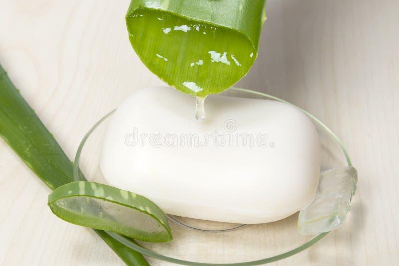 Aloe Vera soap. Aloe Vera leaf with juice and soap stock photos