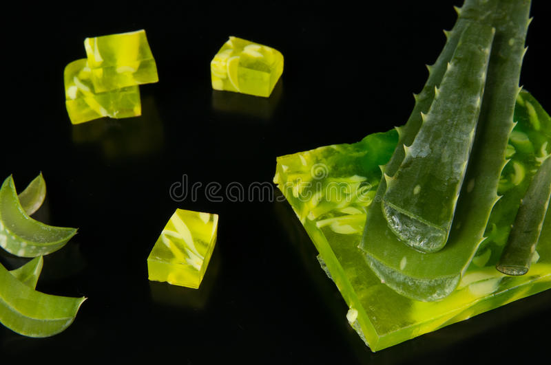 Aloe vera and soap. Leaves of aloe vera and soap with pieces of aloe stock photo
