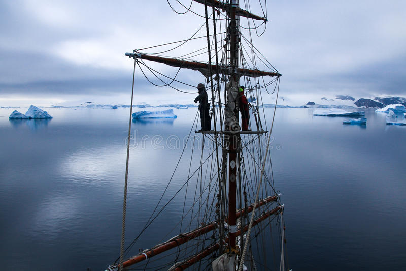 Aloft in a tallship, sailboat in Antarctica stock photography