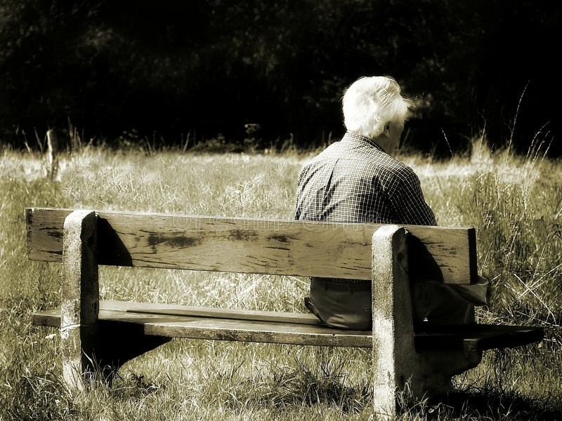 Alone. Old man sitting on bench