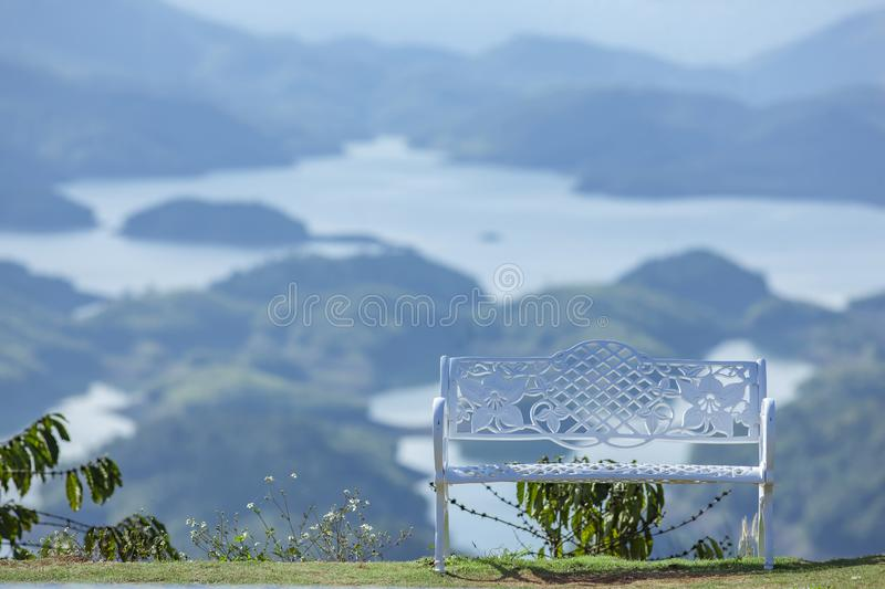 The alone bench on the top of mountain. around the TaDung Lake, white cloud on the blue sky royalty free stock photos