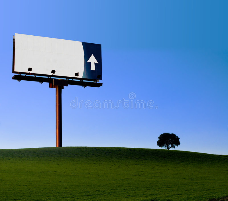 Alone billboard in a green mea royalty free stock photography
