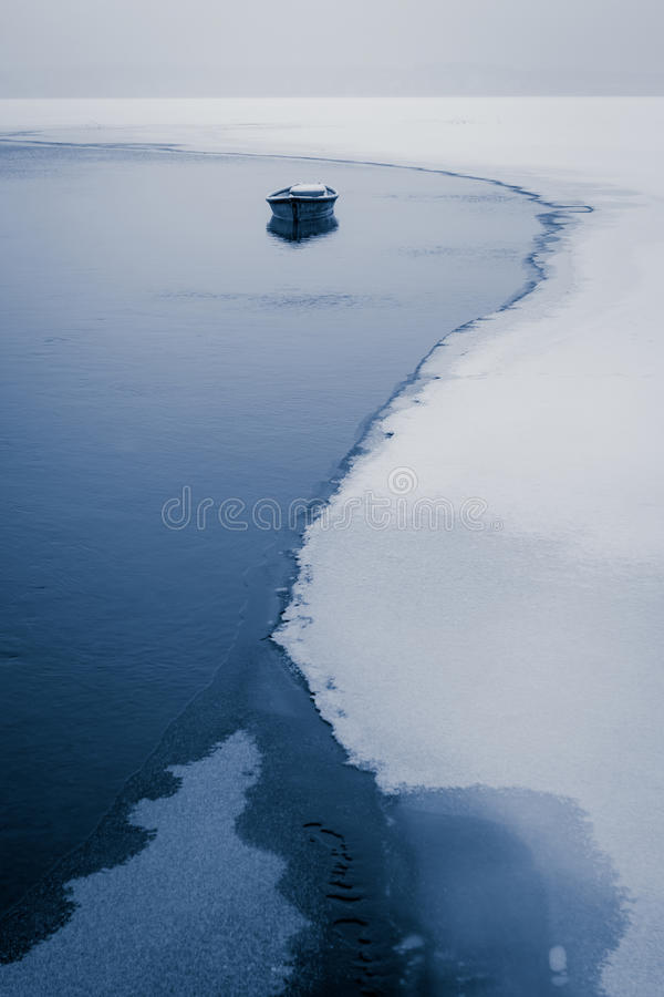 Alone Boat On Frozen River Royalty Free Stock Photo