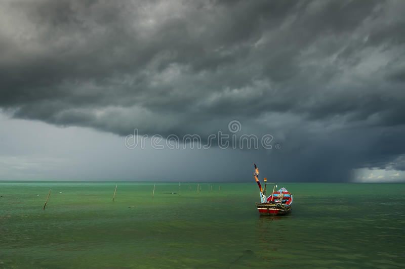 Alone boat with rain cloud stock photography