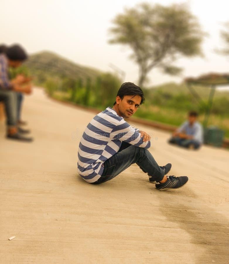 Alone Boy Sitting On Road stock photo