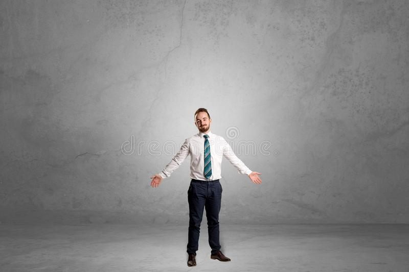 Alone businessman standing in a dark room royalty free stock photo