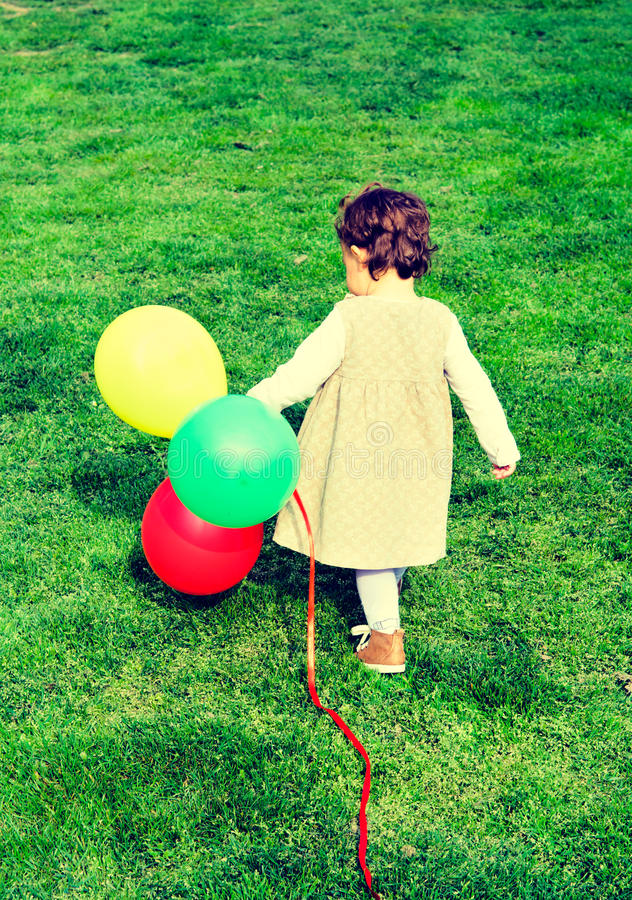 Free Alone Child With Balloons Royalty Free Stock Image - 39461796