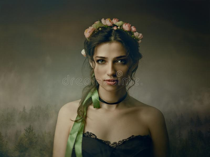 Alone from darkness. Spooky female portrait royalty free stock photo