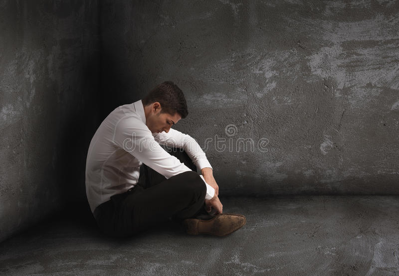 Alone desperate businessman. solitude and failure concept. Alone desperate businessman sits on the floor. solitude and failure concept royalty free stock photography