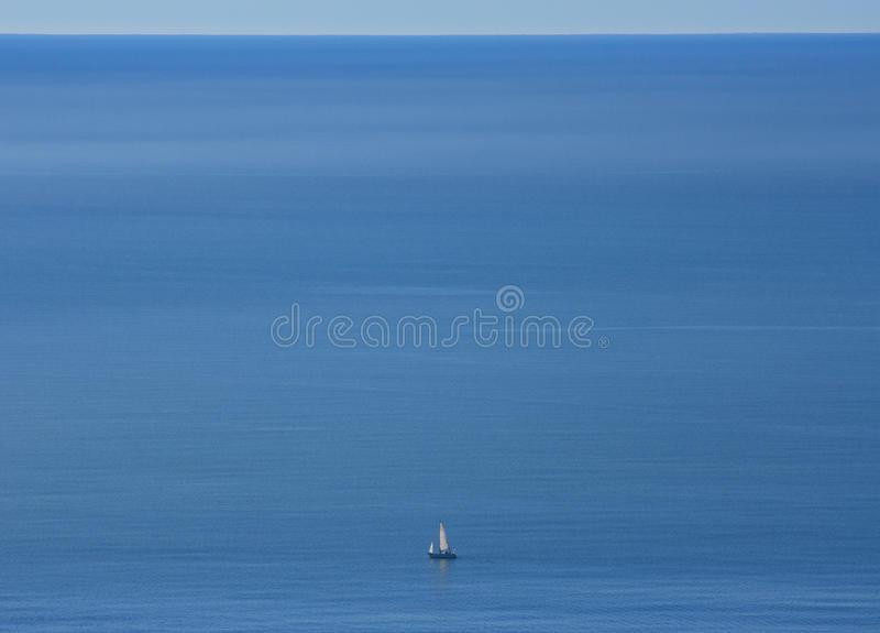 Alone on an empty ocean stock photo