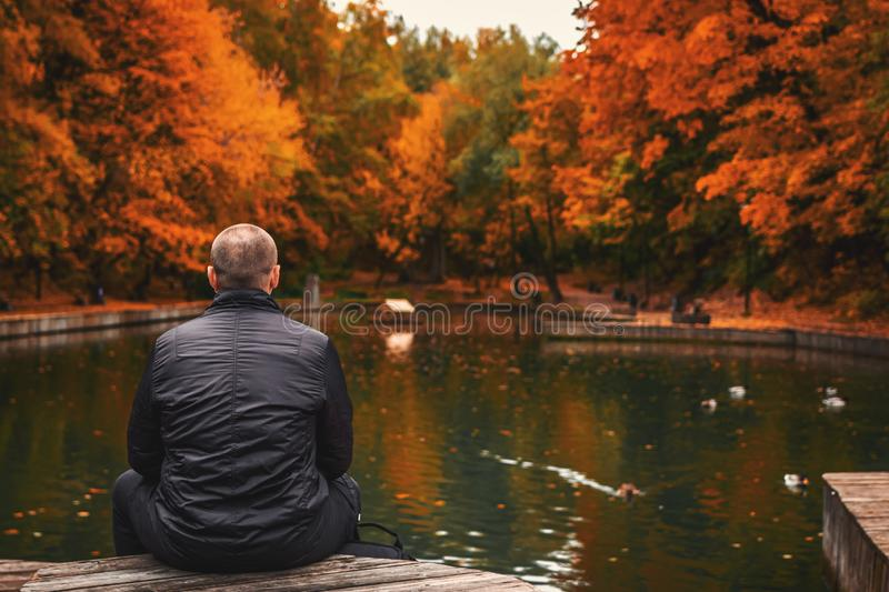 Alone Man Sits Beside A Pond In The Park. Autumn Background. Free Public Domain Cc0 Image