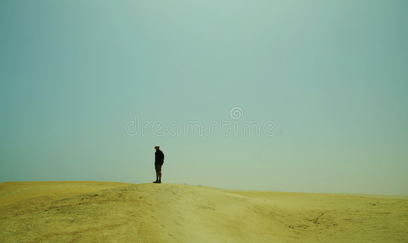 Alone men in the desert royalty free stock photography
