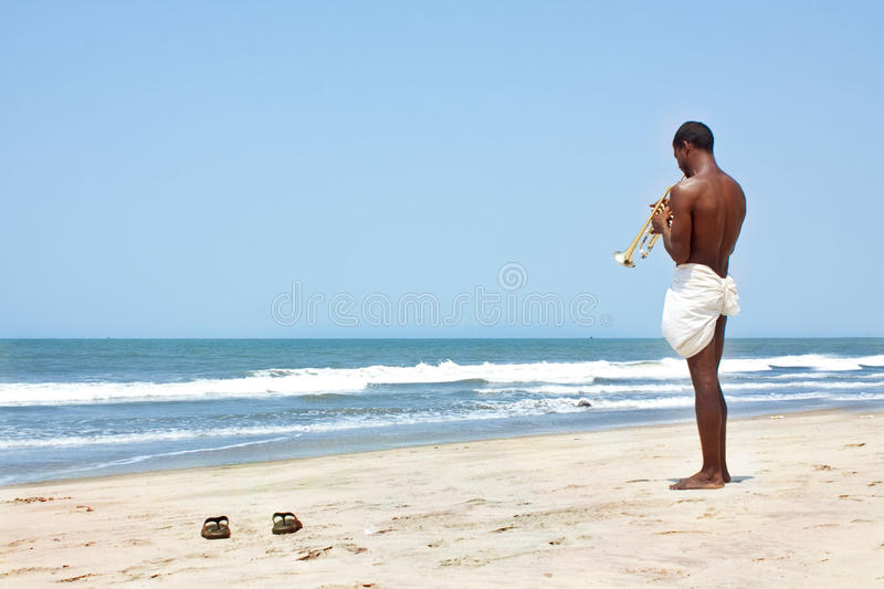 Alone musician on the beach stock photo