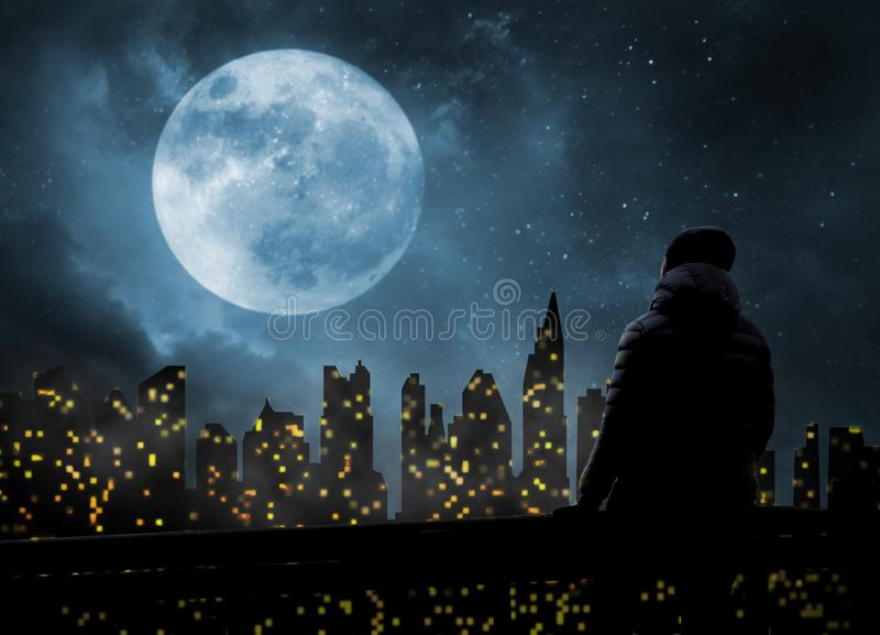 Alone in a big city at night. Alone person in a big city at night stock photo