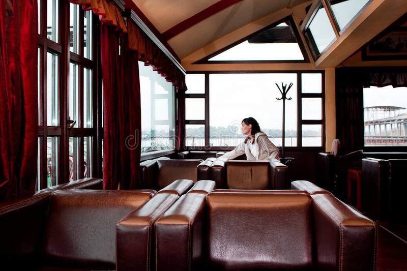 Alone in restaurant. Alone woman sitting in restaurant royalty free stock photography