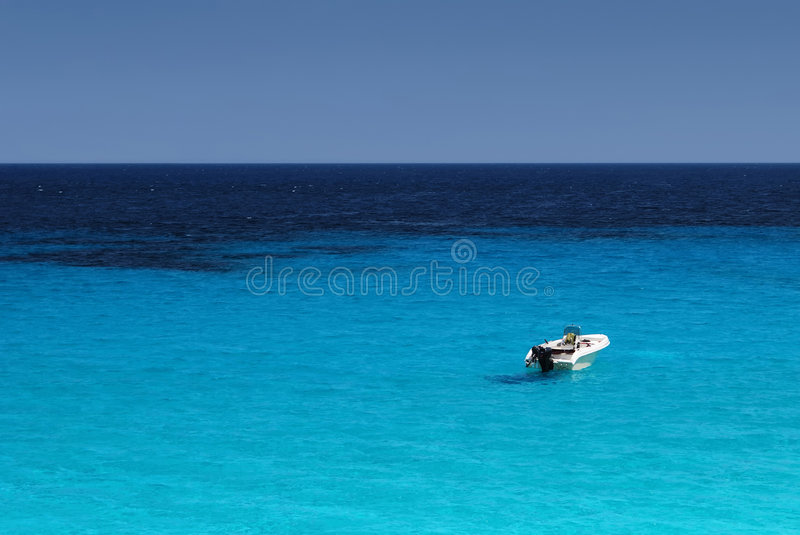 Alone in the sea stock image