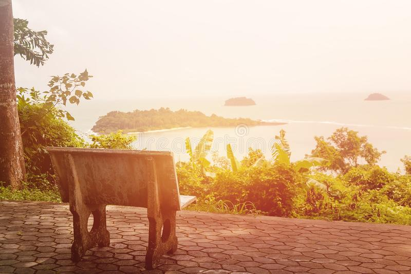 Alone stone chair with sea view. Alone stone chair on the floor view sea and islands background with morning time stock image