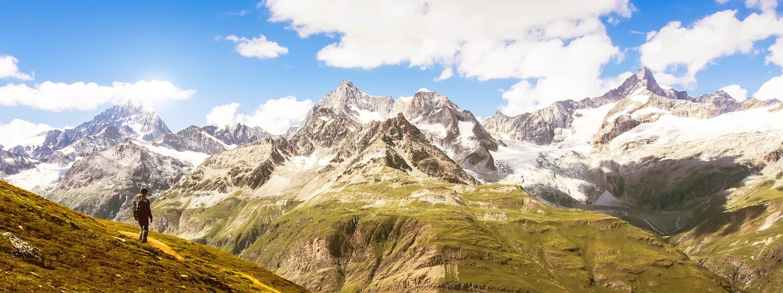 Alone traveler standing at Matterhorn peak in panorama view, Switzerland. Adventure Life travel concept. royalty free stock images