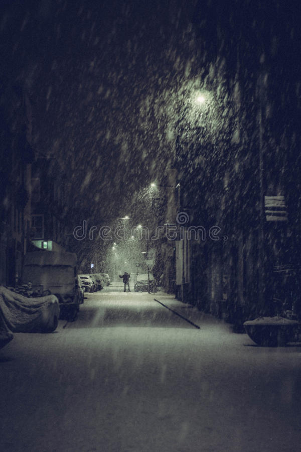 Alone in the winter dark stock images