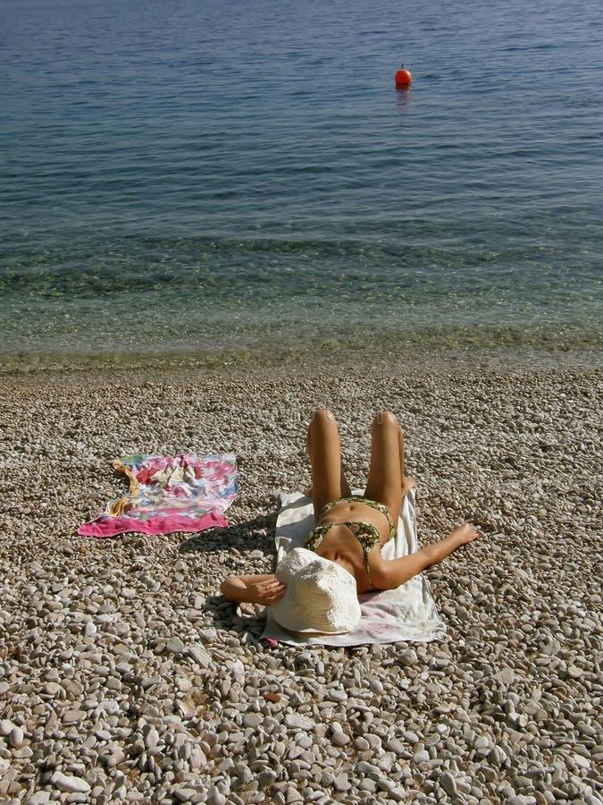 Sunbathing on beach royalty free stock photos