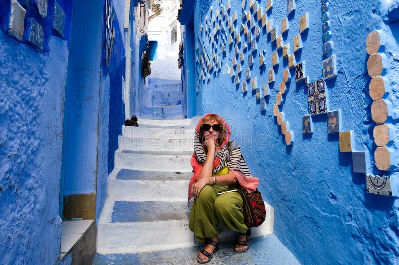 Alone woman in blue city of Chefchaouen,Morocco royalty free stock photos