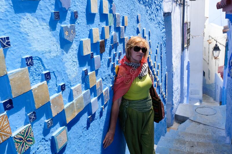 Alone woman in blue city of Chefchaouen,Morocco stock photo