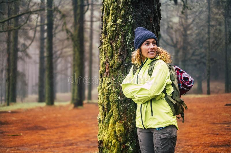 Alone woman with cold and winter clothes enjoy the outdor leisure activity in the forest the forest with trees - vacation and trip stock image