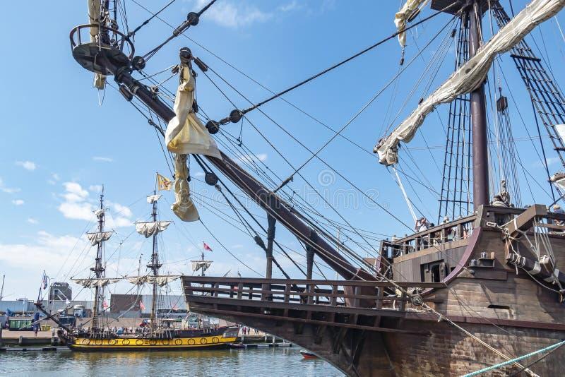 Along the bow of El Galeón you can see ship Shtandart during Sail on Scheveningen.  stock image