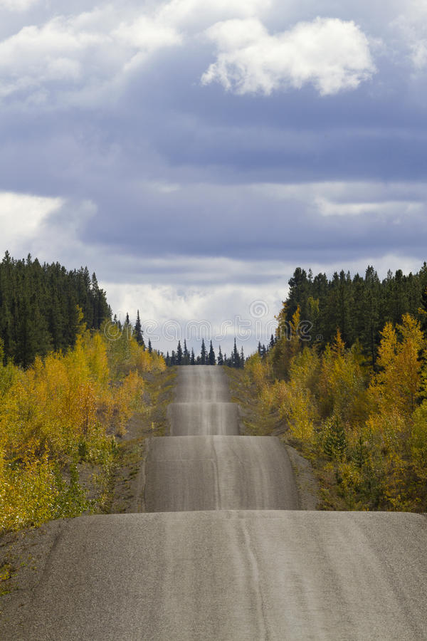 Along Cassiar-Stewart Highway in British Columbia. Autumn along the adventurous rise and fall of Cassiar-Stewart Highway in British Columbia. Vertical photograph stock photography