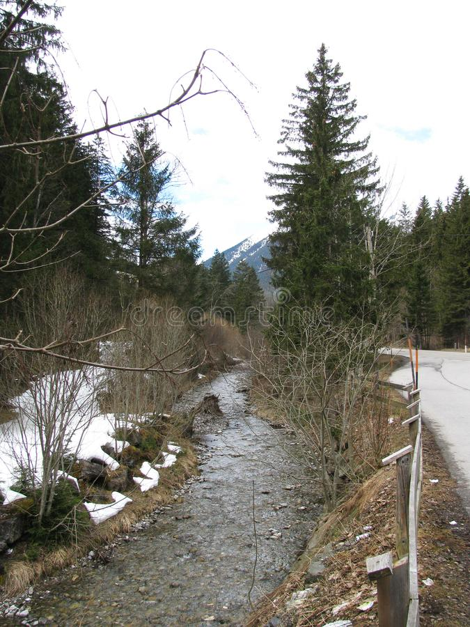 This is the road on the border between Germany and Austria in the spring. Along the road leading from Austria to Germany , alternate Alps, river, forests royalty free stock photos