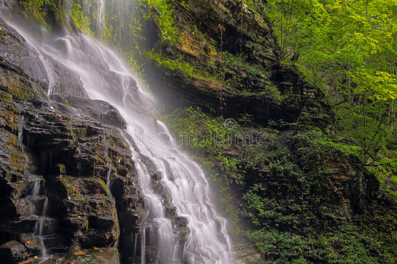 Alongside Cathedral Falls. Cathedral Falls, a waterfall in West Virginia's scenic New River Gorge is viewed from alongside in late summer stock image