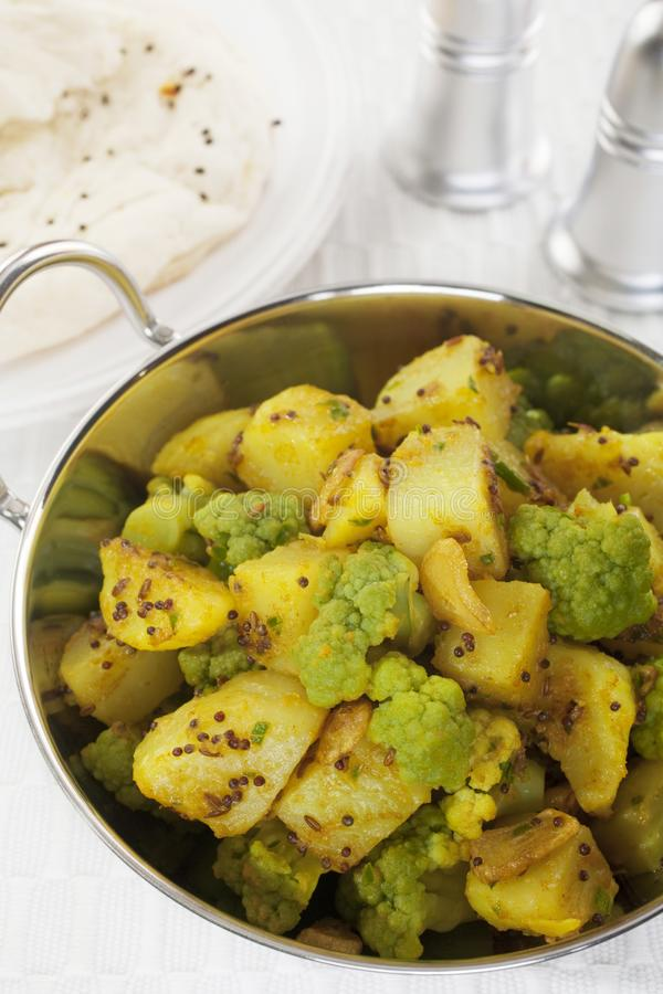 Aloo Ghobi Cauliflower Potato Curry Indian Vegetarian Food Meal. A South Indian dish, cauliflower and potato curry is known as aloo ghobi in the West. It`s stock photos