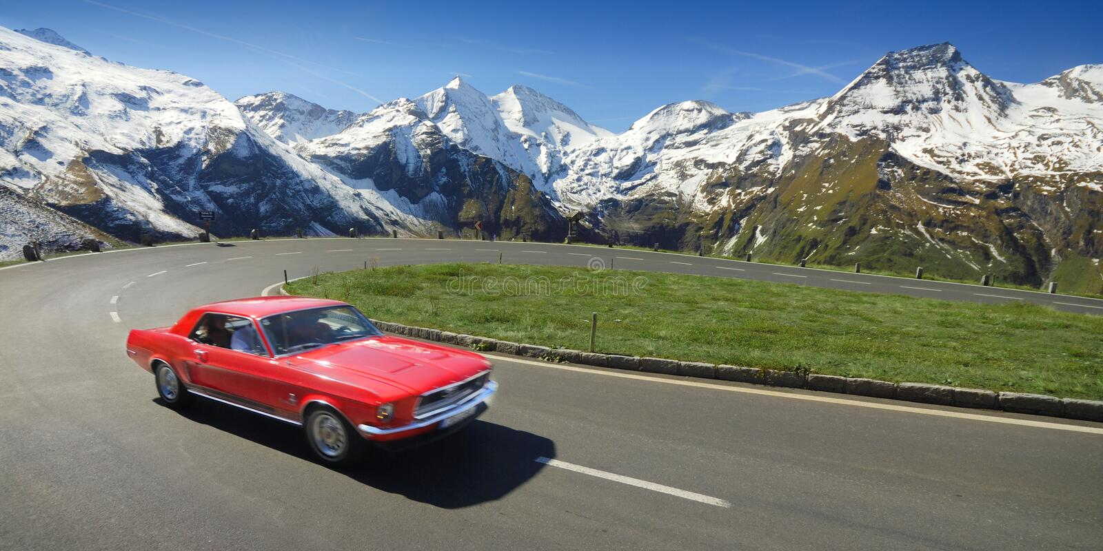 Alpen Drive. Alpen high mountains road with family car stock photography