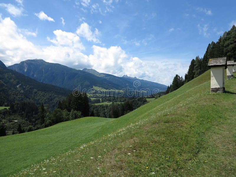 Alpen mountains, Austria - traditional mountains village stock photography